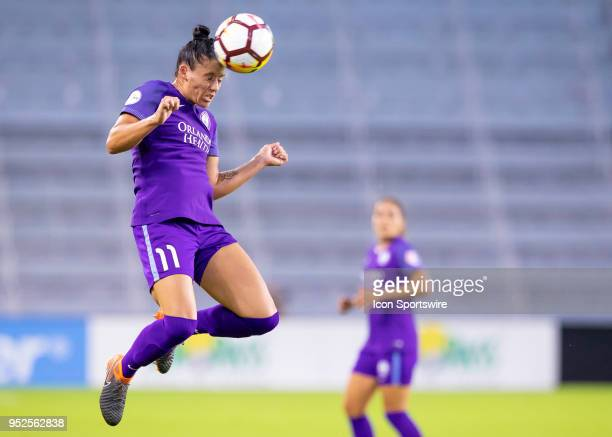 Orlando Pride defender Ali Krieger takes a header during the NWSL soccer match between the Orlando Pride and the Seattle Reign on April 28 2018 at...