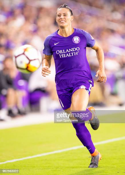 Orlando Pride defender Ali Krieger toys to run down the long pass during the NWSL soccer match between the Orlando Pride and the Seattle Reign on...