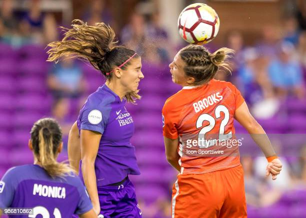 Orlando Pride forward Alex Morgan and Houston Dash defender Amber Brooks challenge for a header during the NWSL soccer match between the Orlando...