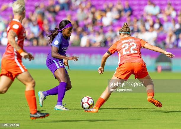 Orlando Pride forward Chioma Ubogagu looks to shoot on goal as Houston Dash defender Amber Brooks defends during the NWSL soccer match between the...