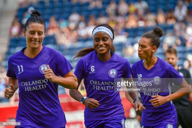 Orlando Pride forward Chioma Ubogagu warms up with Orlando Pride's Ali Krieger and Orlando Pride's Kristen Edmonds before the game against the...