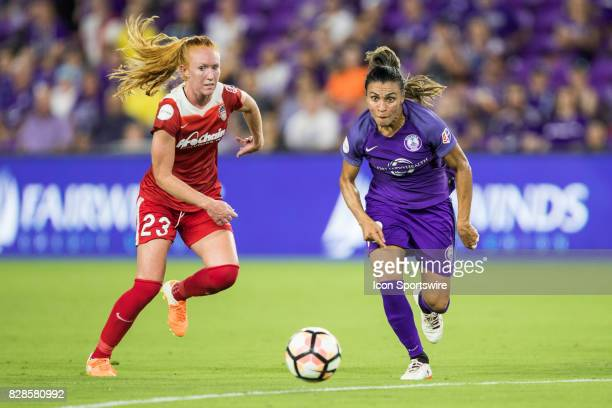 Orlando Pride forward Marta and Washington Spirit midfielder Tori Huster go for the ball during the NWSL soccer match between the Orlando Pride and...