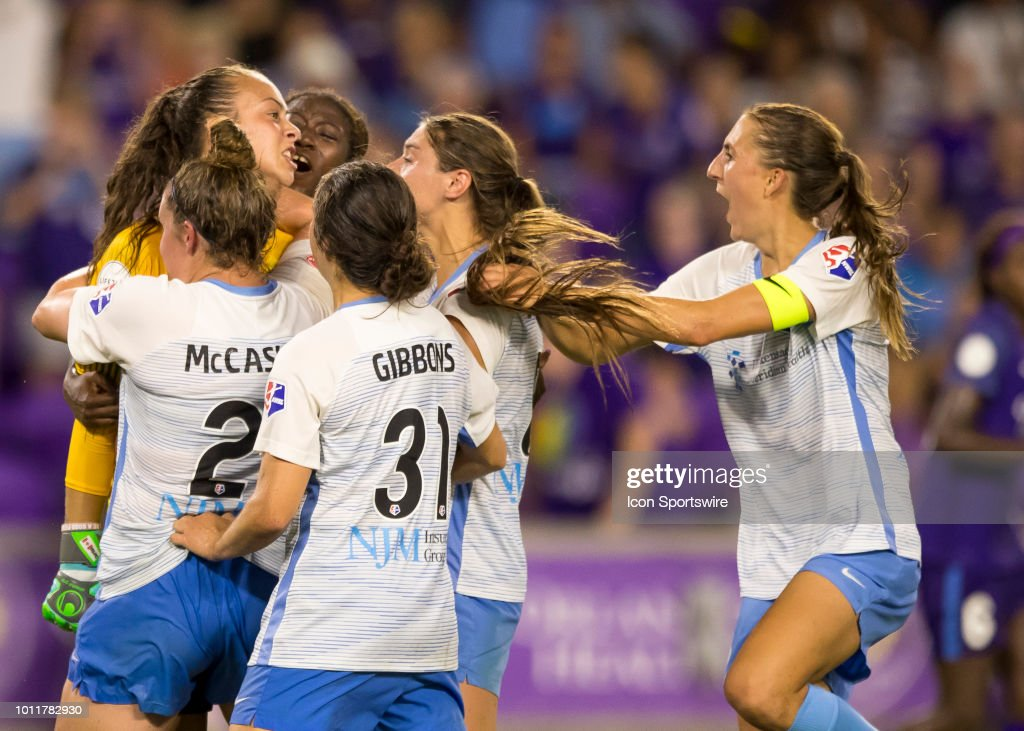 Orlando Pride forward Marta (10) shoots hard but miss chooses her spot as Sky Blue FC goalkeeper Kailen Sheridan (1) make a game saving PK save during the NWSL soccer match between the Orlando Pride and New Jersey Sky Blue FC on August 5th, 2018 at Orlando City Stadium in Orlando, FL.