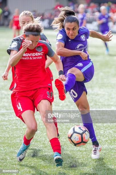 Orlando Pride forward Marta takes a shot blocked by Portland Throns defender Emily Menges during the play offs semifinals between the Portland Thorns...