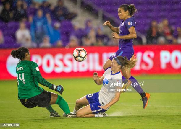 Orlando Pride forward Marta Vieira da Silva challenges the Boston Breakers goalkeeper Abby Smith and Boston Breakers defender Christen Westphal...