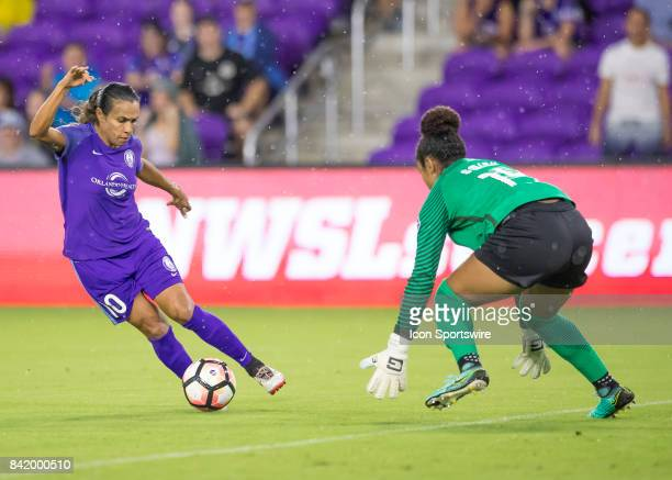 Orlando Pride forward Marta Vieira de Silva looks to shoot on goal at Boston Breakers goalkeeper Abby Smith during the NWSL soccer match between the...