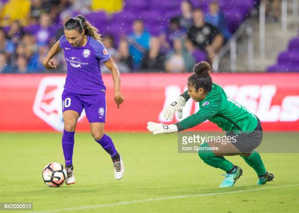 Orlando Pride forward Marta Vieira de Silva prepares to shoot on goal at Boston Breakers goalkeeper Abby Smith during the NWSL soccer match between...