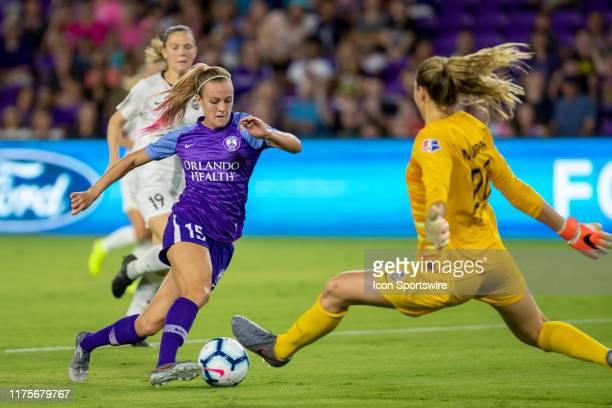 Orlando Pride forward Rachel Hill kicks the ball past Seattle Reign FC goalkeeper Casey Murphy for a goal during the soccer match between Reign FC...