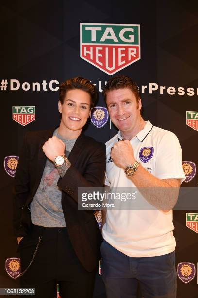 Orlando Pride Goalkeeper Ashlyn Harris and Orlando City Head Coach James O'Connor pose during the 'TAG Heuer Celebrate Partnership with the Orlando...
