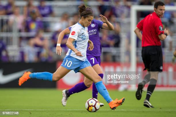 Orlando Pride midfielder Christine Nairn and Sky Blue FC midfielder Carli Lloyd go for the ball during the soccer match between The Orlando Pride and...