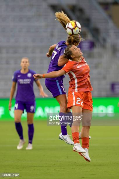 Orlando Pride midfielder Dani Weatherholt and Houston Dash defender Amber Brooks go up for a header during the soccer match between the Orlando Pride...