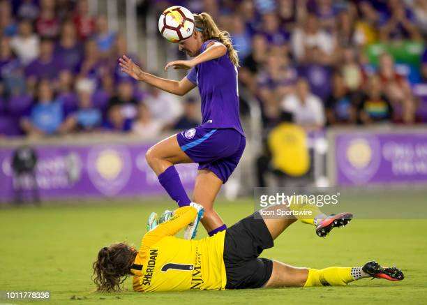 Orlando Pride midfielder Dani Weatherholt scores a goal header on a misplayed ball from Sky Blue FC goalkeeper Kailen Sheridan during the NWSL soccer...