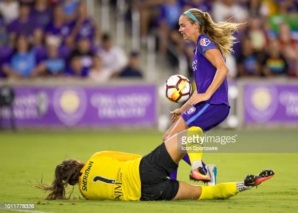 Orlando Pride midfielder Dani Weatherholt scores a goal on a misplayed ball from Sky Blue FC goalkeeper Kailen Sheridan during the NWSL soccer match...
