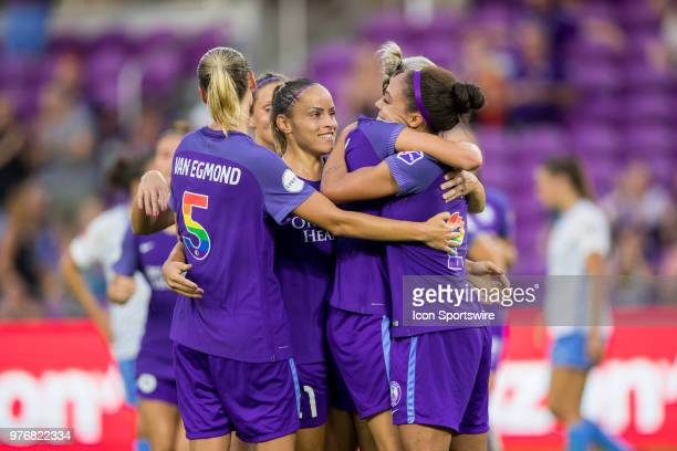Orlando Pride players celebrate after scoring a goal during the soccer match between The Orlando Pride and Sky Blue FC on June 16 2018 at Orlando...