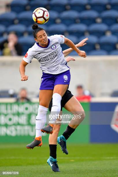 Orlando Pride's Ali Krieger heads the ball against the Chicago Red Stars on May 2 2018 at Toyota Park in Bridgeview Illinois