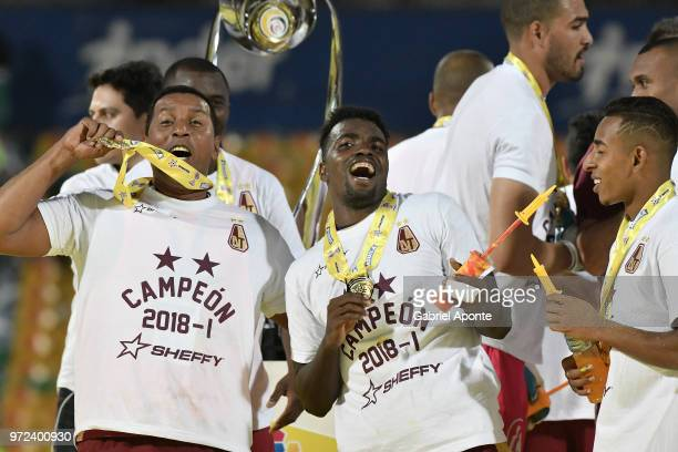 Orlando Rojas coach assistant Marco Perez and Sebastian Villa of Tolima celebrate as champions of the Liga Aguila I 2018 after the second leg match...