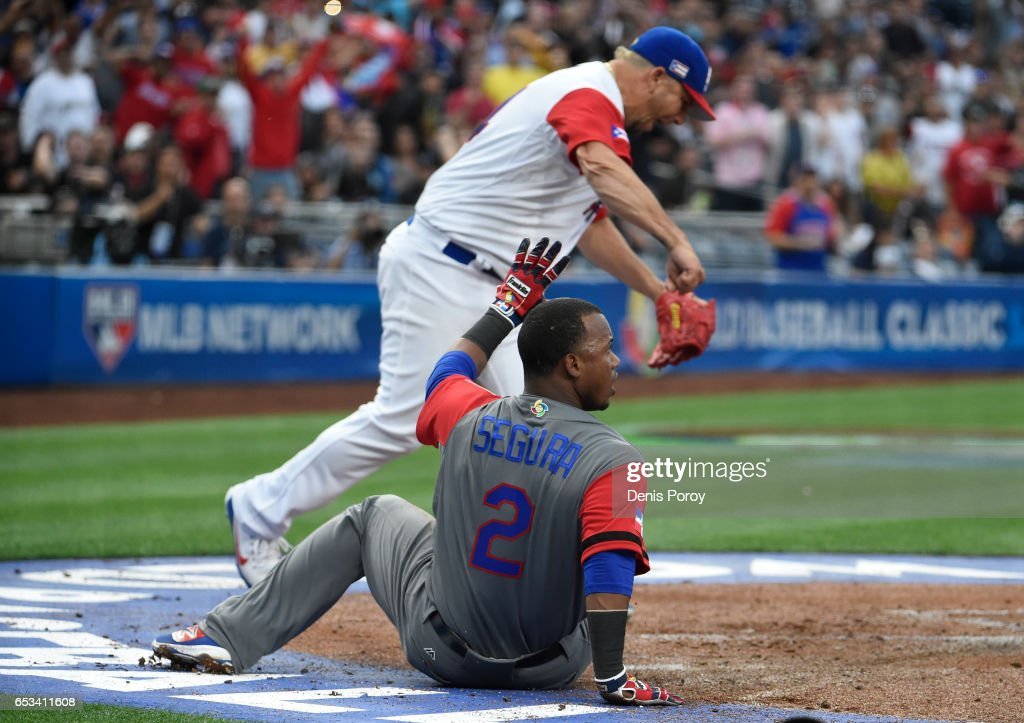 Orlando Roman #34 of Puerto Rico reacts after Jean Segura #2 of the Dominican Republic was tagged out at the plate during the first inning of World Baseball Classic Pool F Game One between the Dominican Republic and Puerto Rico at PETCO Park on March 14, 2017 in San Diego, California.