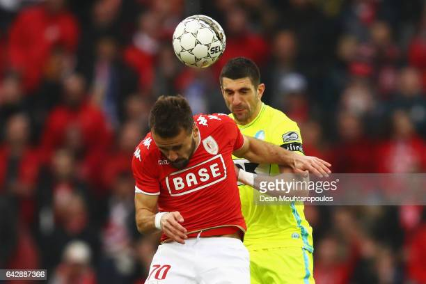 Orlando Sa of Standard Liege battles for the ball with Stefan Mitrovic of KAA Gent during the Belgian Jupiler Pro League match between Royal Standard...