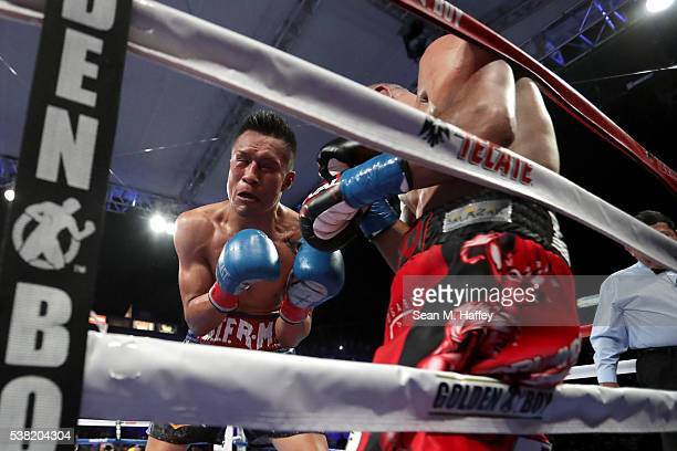 Orlando Salido lands a right to the head of Francisco Vargas during their WBC super featherweight championship bout at StubHub Center on June 4 2016...