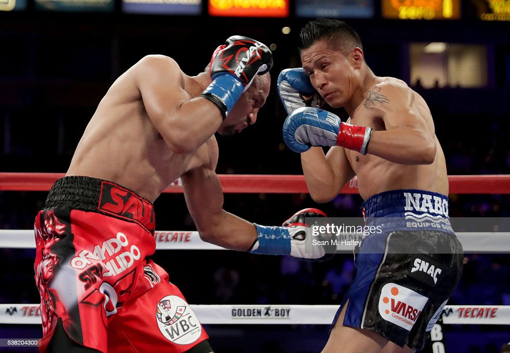 Orlando Salido (L) throws a body shot at Francisco Vargas into the ropes during their WBC super featherweight championship bout at StubHub Center on June 4, 2016 in Carson, California.