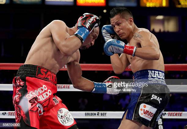 Orlando Salido throws a body shot at Francisco Vargas into the ropes during their WBC super featherweight championship bout at StubHub Center on June...