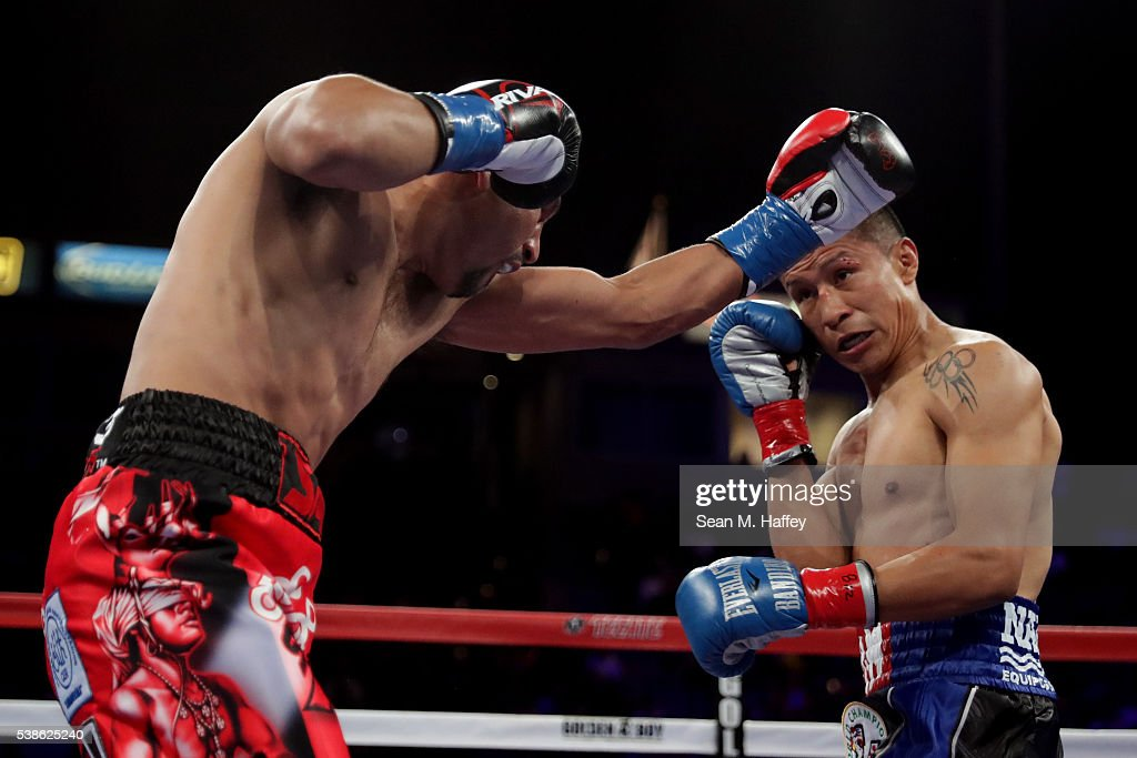 Orlando Salido (L) throws a left to the head of Francisco Vargas during their WBC super featherweight championship bout at StubHub Center on June 4, 2016 in Carson, California.