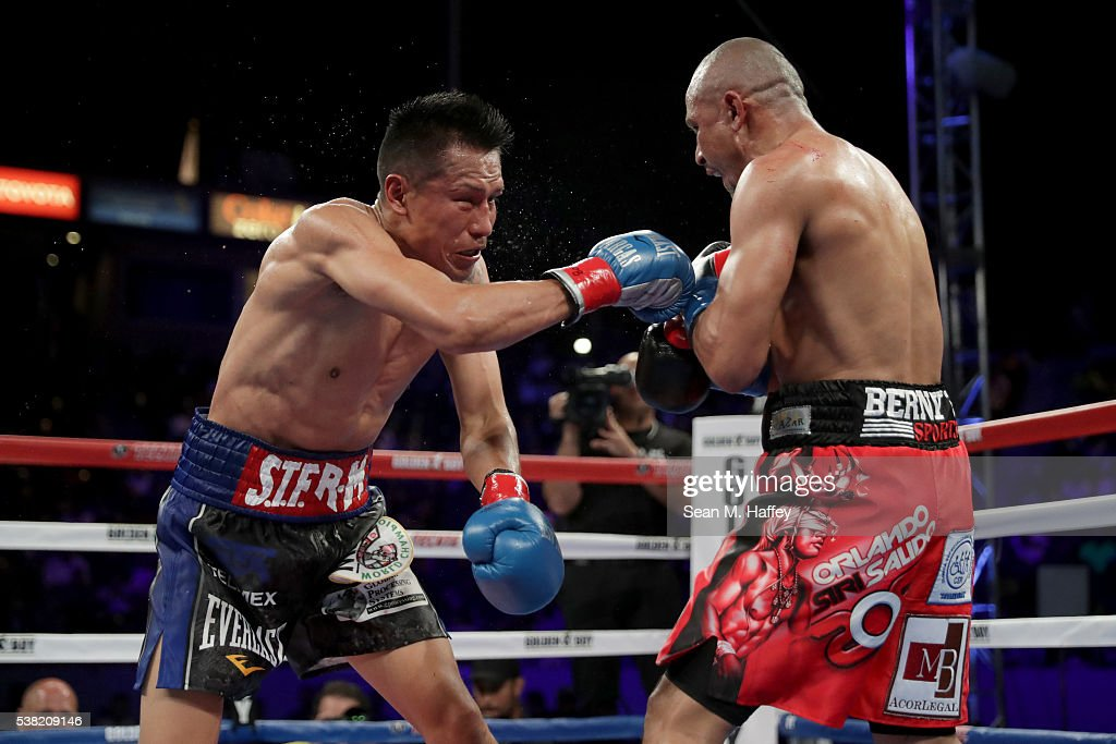 Orlando Salido (R) throws a right at Francisco Vargas during their WBC super featherweight championship bout at StubHub Center on June 4, 2016 in Carson, California.