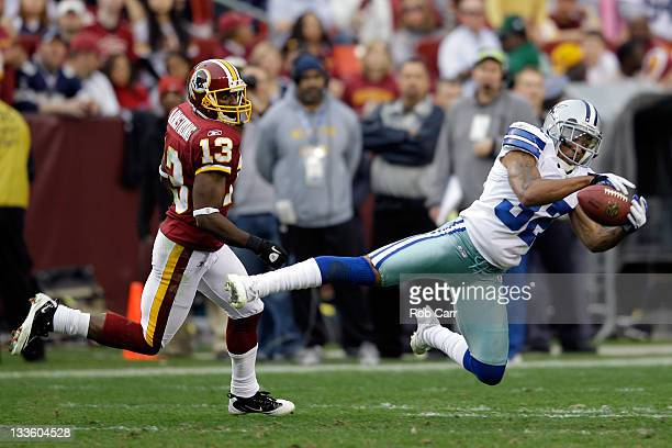 Orlando Scandrick of the Dallas Cowboys intercepts a pass intended for Anthony Armstrong of the Washington Redskins during the second half at...