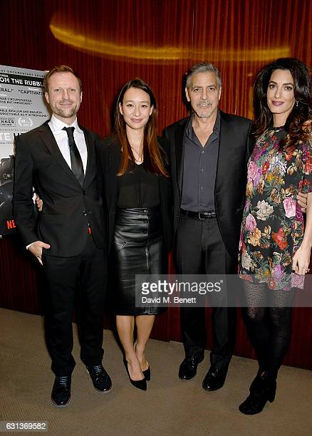 Orlando von Einsiedel Joanna Natasegara George Clooney and Amal Clooney attend the Netflix special screening and reception of The White Helmets...