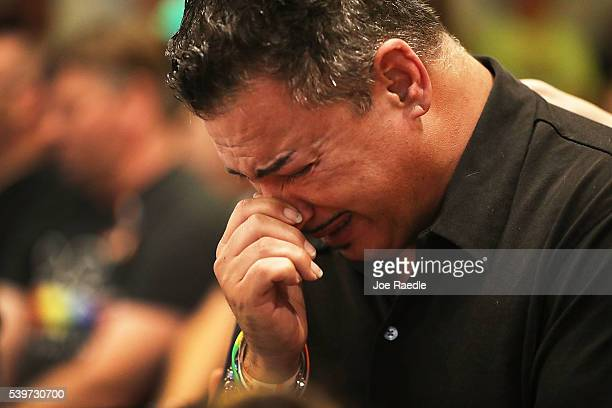 Orlando who was injured in the mass shooting at the Pulse Nightclub cries as he attends a memorial service at the Joy MCC Church for the victims of...
