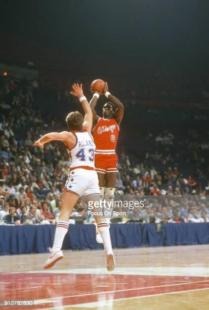 Orlando Woolridge of the Chicago Bulls shoots over Jeff Ruland of the Washington Bullets during an NBA basketball game circa 1981 at the Capital...