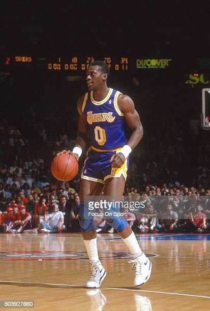 Orlando Woolridge of the Los Angeles Lakers dribbles the ball against the Philadelphia 76ers during an NBA basketball game circa 1989 at The Spectrum...