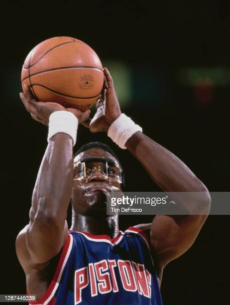 Orlando Woolridge, Small Forward for the Detroit Pistons prepares to make a free throw during the NBA Midwest Division basketball game against the...