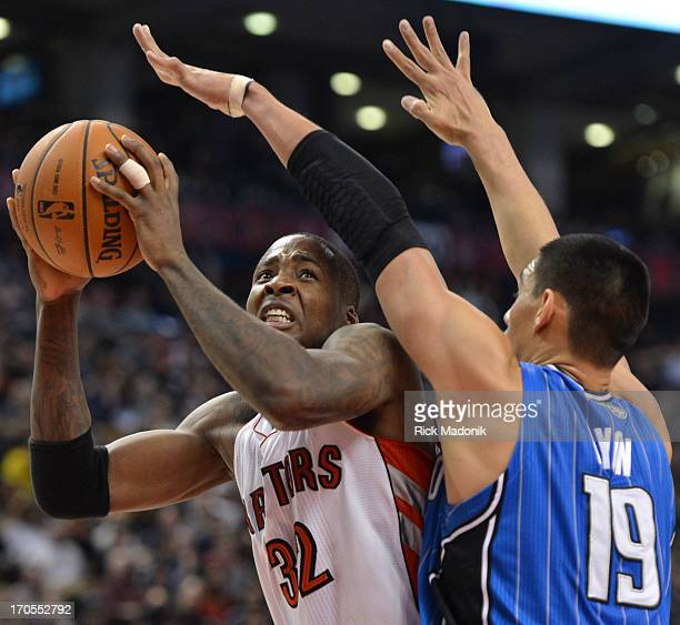 121221 TORONTO ONTARIO Orlando's Gustavo Ayon closely guards Ed Davis during NBA action between Toronto Raptors and Orlando Magic at Air Canada...
