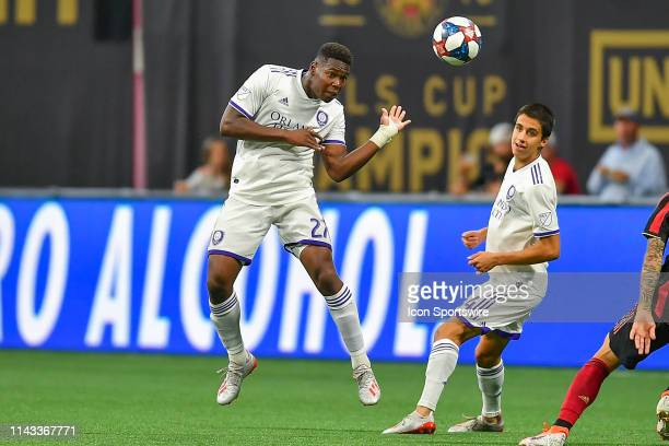 Orlando's Kamal Miller heads the ball during the MLS match between Orlando City SC and Atlanta United FC on May 12th 2019 at Mercedes Benz Stadium in...