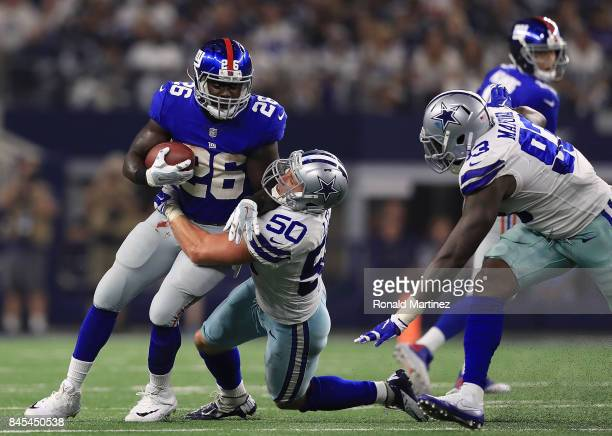 Orleans Darkwa of the New York Giants gets stopped by Sean Lee of the Dallas Cowboys in the second half of a game at AT&T Stadium on September 10,...