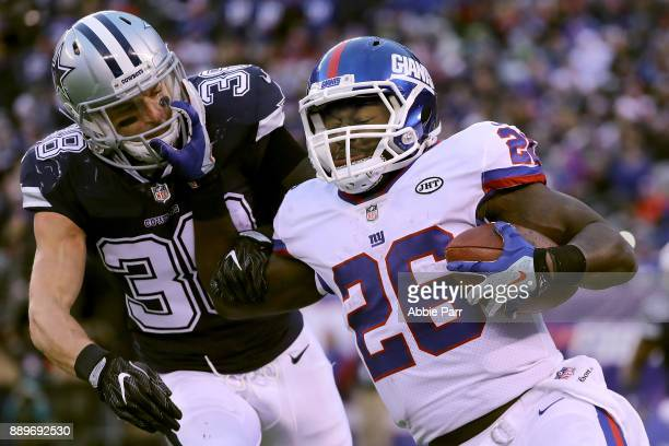 Orleans Darkwa of the New York Giants runs against Jeff Heath of the Dallas Cowboys in the second half during their game at MetLife Stadium on...