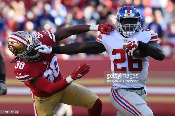 Orleans Darkwa of the New York Giants stiffarms Adrian Colbert of the San Francisco 49ers during their NFL game at Levi's Stadium on November 12 2017...