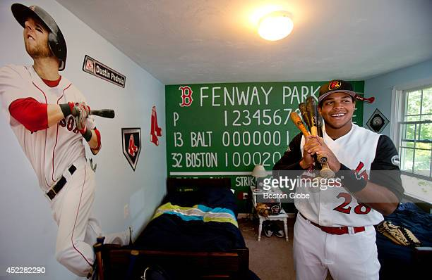 Orleans Firebirds outfielder Tim Robinson a USC student warms up in a room already decorated with a Fenway Monster decor that he shares with Owen...