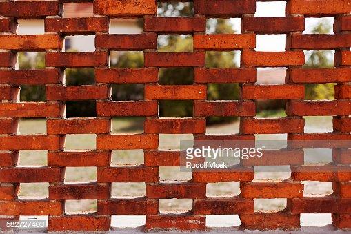 Ornamental Brick Wall With Holes Stock Photo