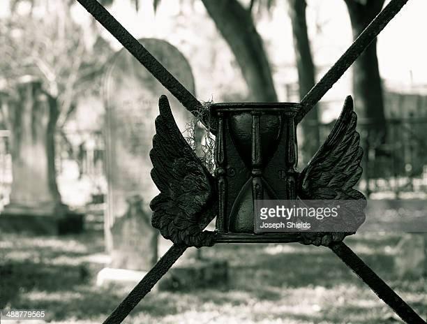 ornamental detail of cemetery gate - grab stock-fotos und bilder