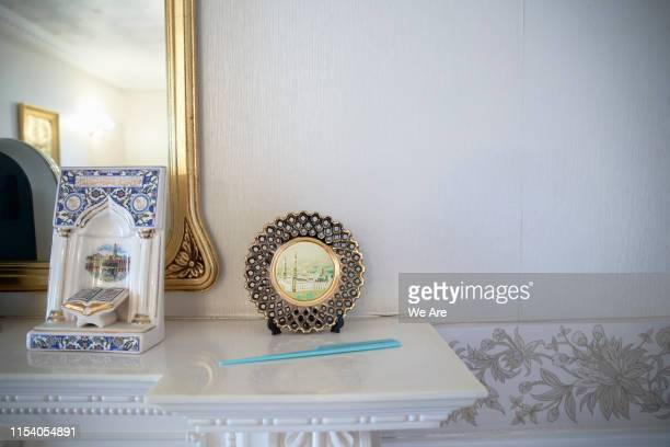 ornamental religious objects on mantlepiece - religious symbol stock pictures, royalty-free photos & images