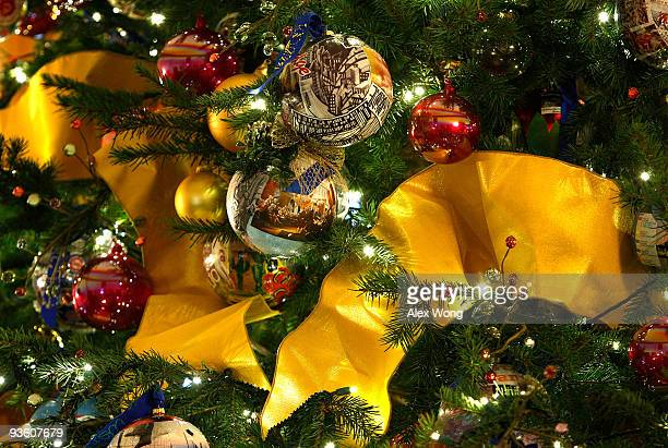 Ornaments are hung on the official White House Christmas Tree a Douglas Fir stands 18 1/2 feet high and nearly 13 feet wide in the Blue Room December...