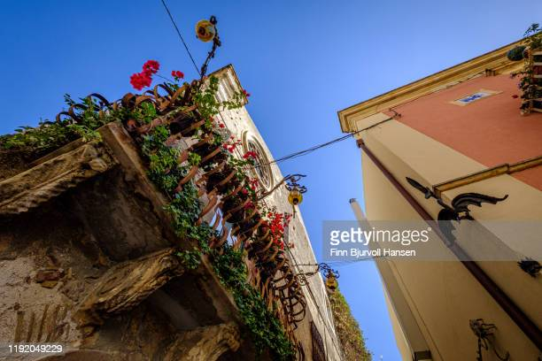 ornaments, decorations and flowers on buildings in taormina, sicily, italy - finn bjurvoll stock pictures, royalty-free photos & images
