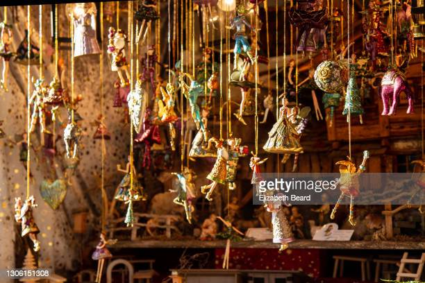 ornaments for sale at nuremberg christmas market, germany - souvenir stock pictures, royalty-free photos & images