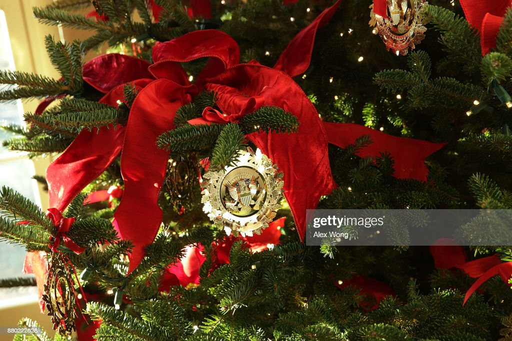 Ornaments on a Christmas tree at the White House during a press preview of the 2017 holiday decorations November 27, 2017 in Washington, DC. The theme of the White House holiday decorations this year is 'Time-Honored Traditions.'