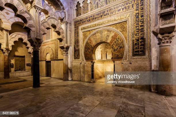 Ornate arches and relief carvings in mosque, Cordoba, Andalusia, Spain
