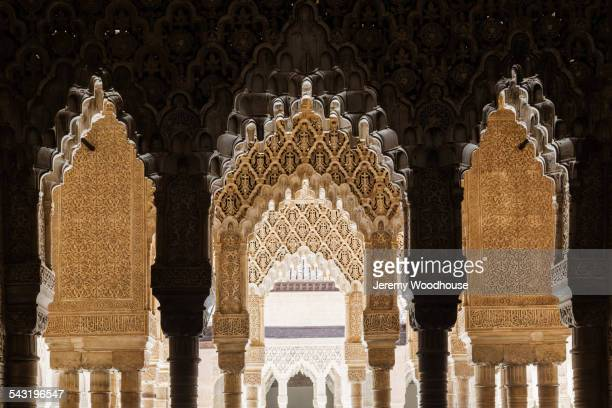 ornate arches on alhambra, granada, andalusia, spain - granada spain landmark stock pictures, royalty-free photos & images