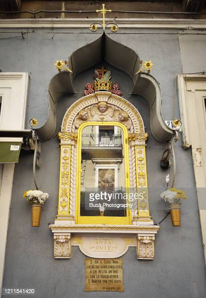 ornate baroque votive aedicula on facade of residential building in catania, sicily, italy - catania stock pictures, royalty-free photos & images