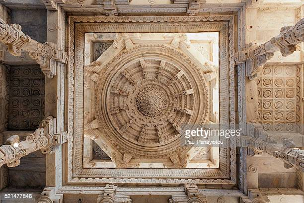 ornate ceiling and pillars, ranakpur jain temple, rajasthan, india - jain temple stock photos and pictures